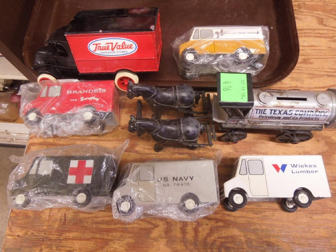 6 Assorted metal Trucks & Bank
