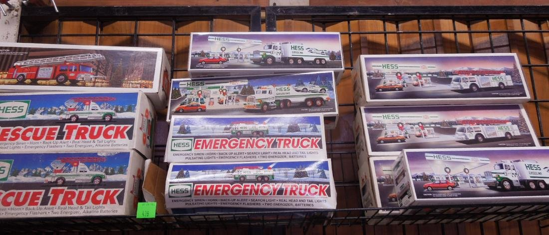 10 Hess Trucks and Fire Truck in Original Boxes