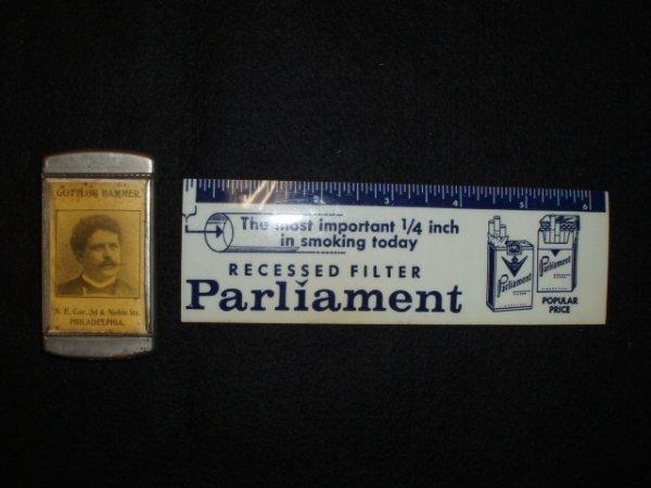 1007: Vintage advertising match safe & ruler