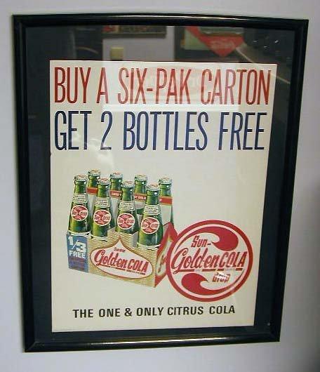 1074: 1960's Golden Cola framed sign
