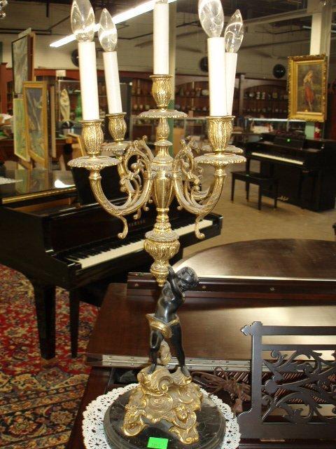 2051: Pr Baroque style figural candelabra