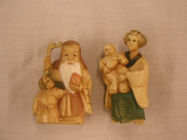 3018: Carved & painted ivory netsukes