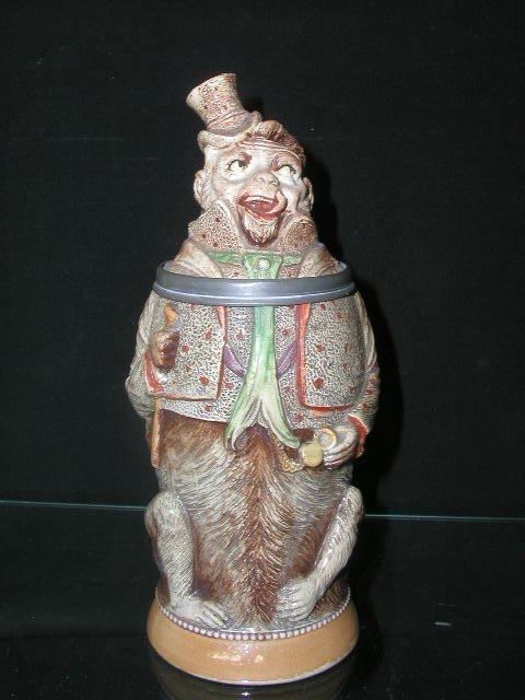 2157: German pottery monkey beer stein
