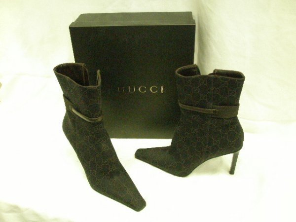 1019: Gucci monogram fabric boots