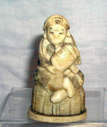 4014: Ivory signed figure