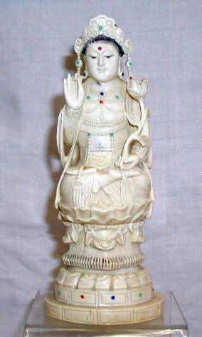 4018: Ivory signed female deity