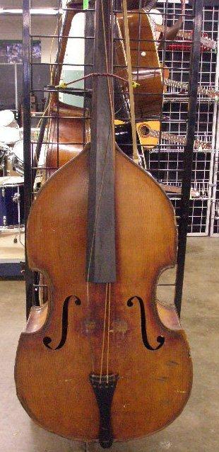 3021: John Juzek carved wood bass