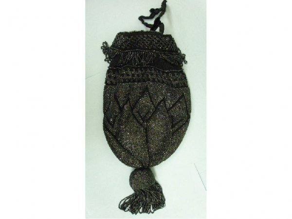 3010: Beaded draw string evening bag