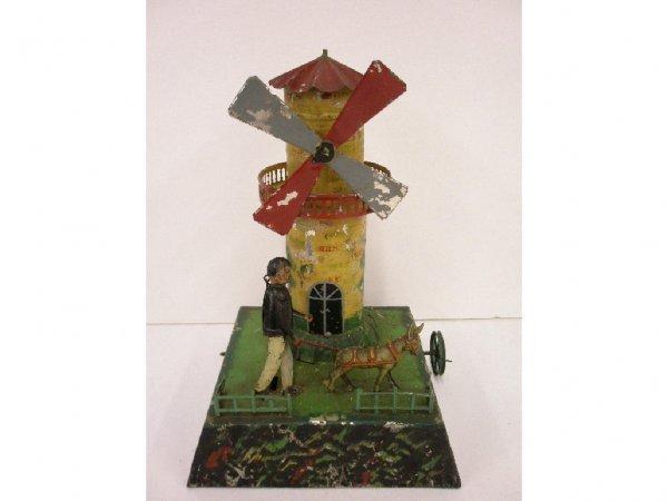 2189: Antique steam driven tin windmill