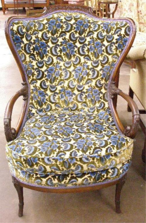 1008: Stylized mahogany wing back open arm chair
