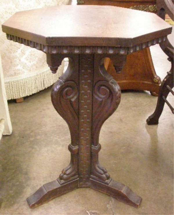 1024: Neoclassical-style carved tripod stand