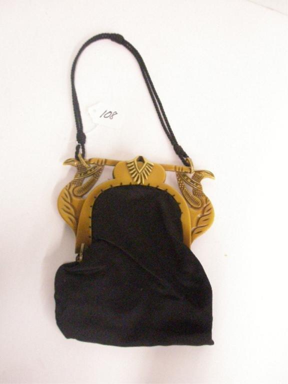 1108: Small black silk pocketbook