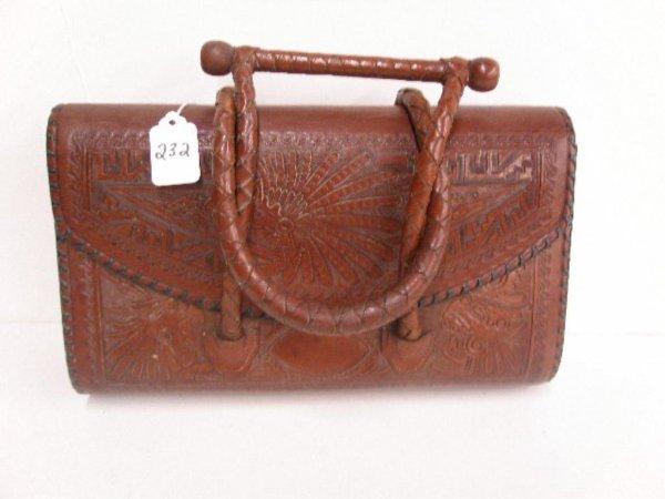 1119: Brown tooled leather handbag