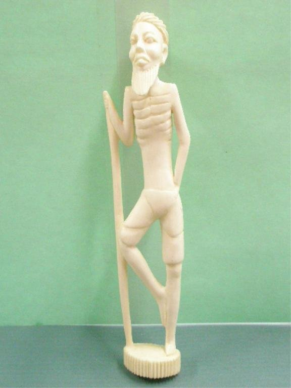 1018: African Carved Ivory Standing Warrior