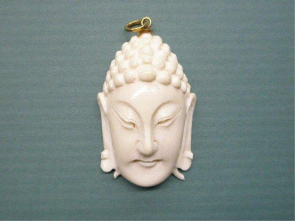 1018A: Ivory buddha Mask Pendant