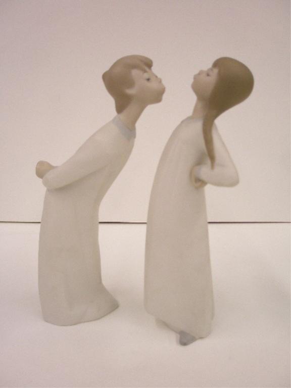 2011: Lladro Boy Blowing & Girl Stretching Figures