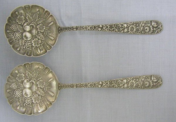 8023: S. Kirk & Son sterling repouse berry spoons