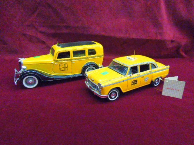 Two Diecast Taxi Cabs