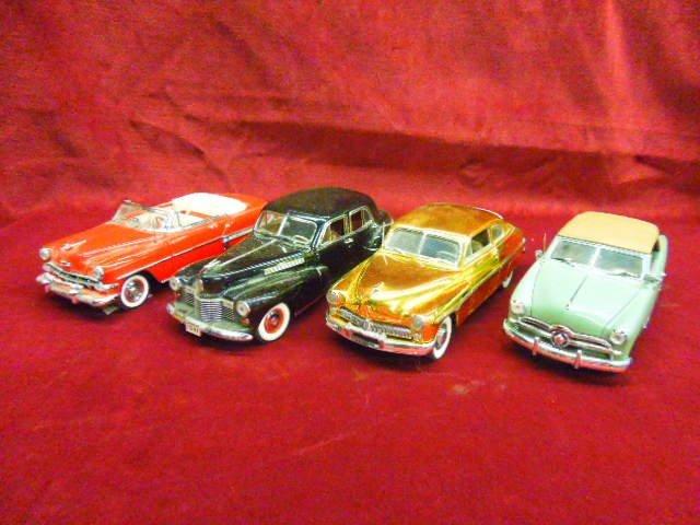 Four Die Cast Cars