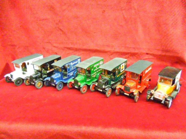 Six Danbury Mint Model T Ford Delivery Trucks