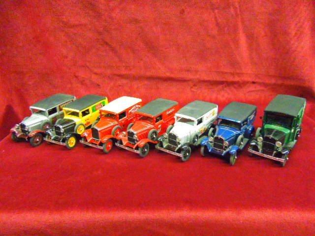 Seven 1930's Delivery Trucks