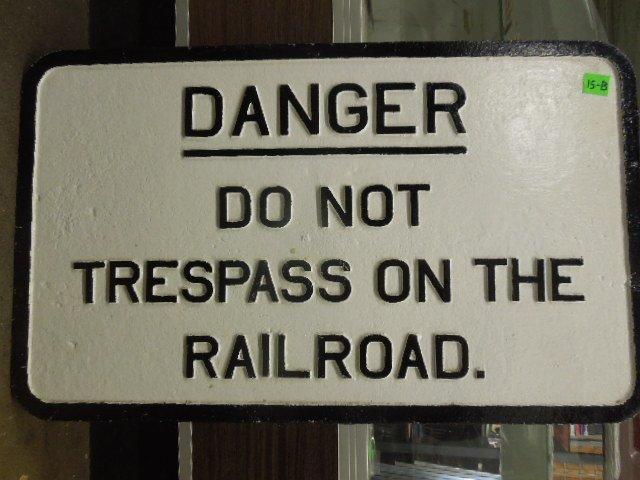 Cast iron warning sign