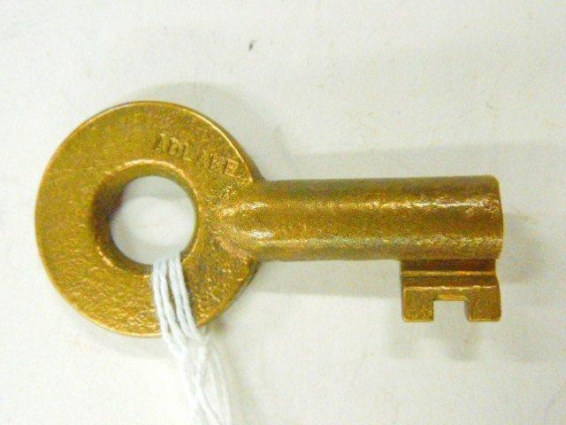 P.C. R.R. brass key