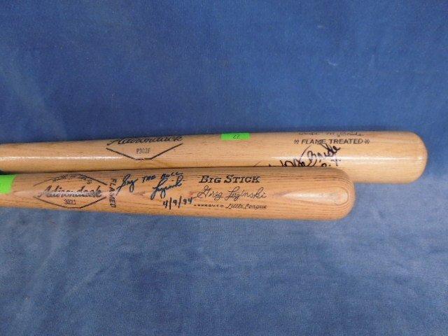 2 Phillies autographed baseball bats