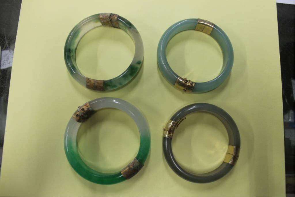 Four Chinese Jade Bangle Bracelets