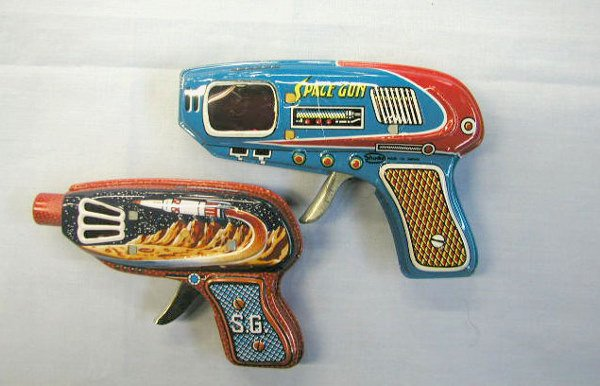 1021: 2 - 60's tin friction space guns