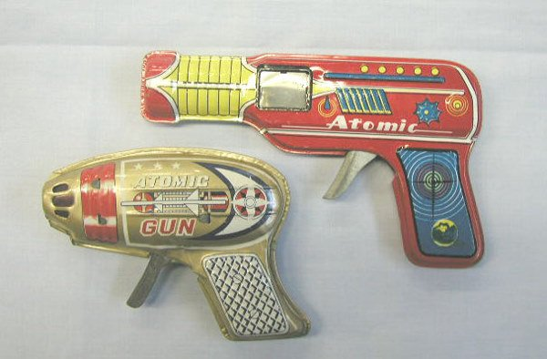 "1023: 2 - 60's tin friction ""Atomic"" guns"