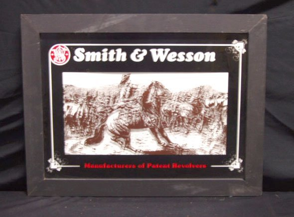 2012: 70's/80's Smith & Wesson framed glass adv. sign