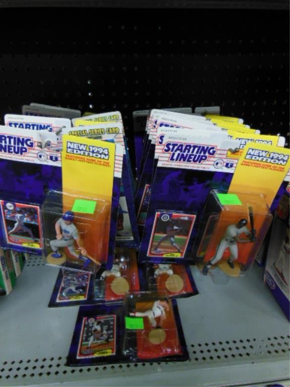 16 Starting Lineup figures in original packages