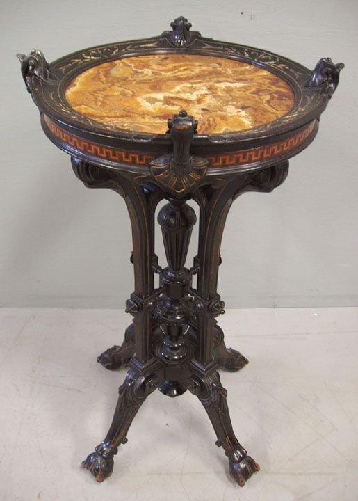 4141: Renaissance Revival marble top ebonized stand