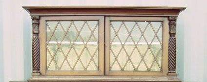 4167: Empire Revival mahogany twin door wall cabinet