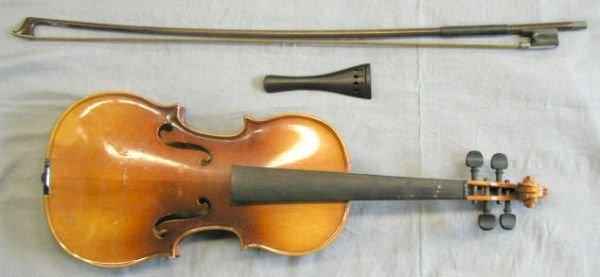 52: 1/2 size violin labeled Stradivarius