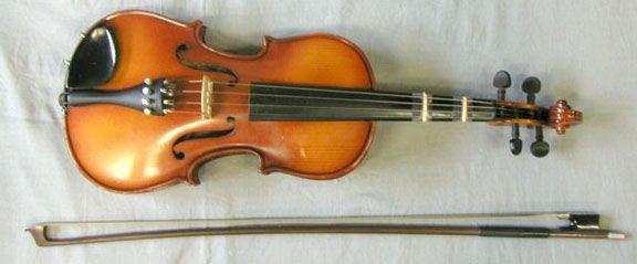54: 1/2 size violin labeled Kyoto Suzuki