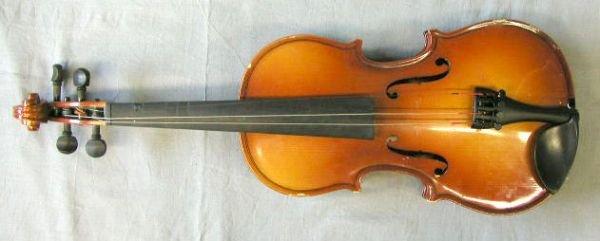 60: 1/2 size violin labeled E.M.Winston