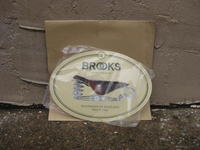 Brooks metal sign new in package