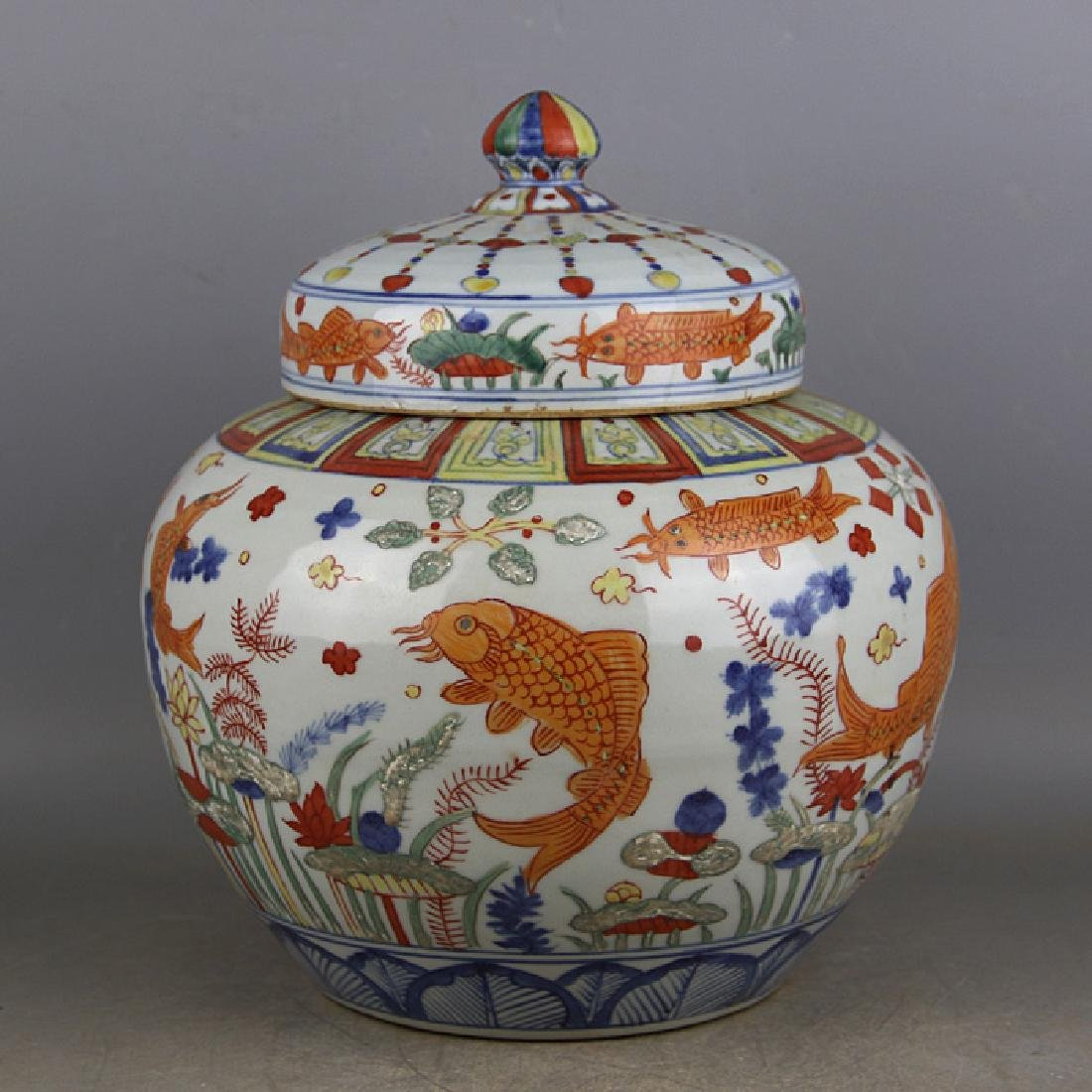 CHINESE PORCELAIN WUCAI FISH AND WEED LIDDED JAR