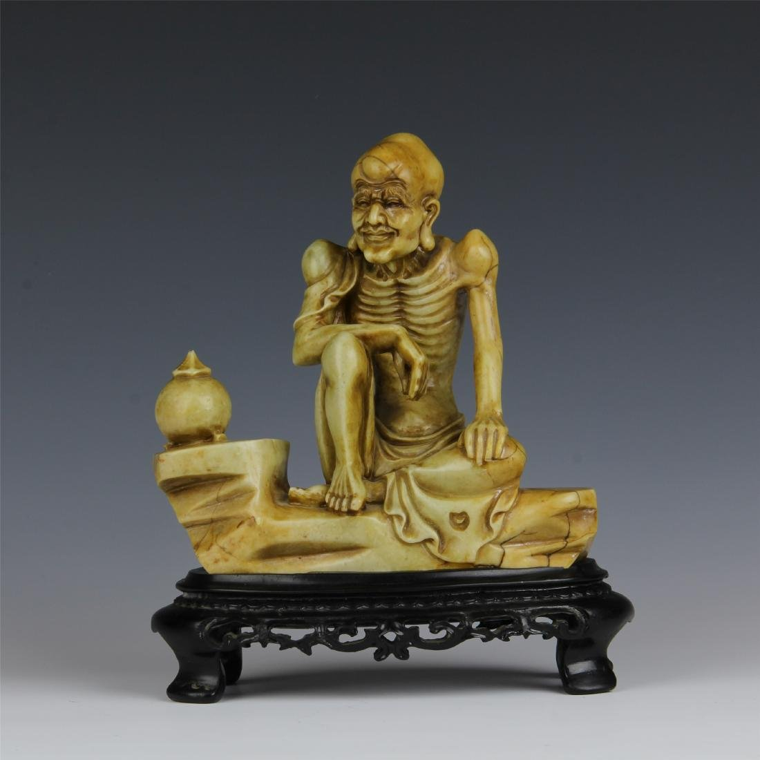 CHINESE SOAPSTONE CARVED SEATED LOHAN