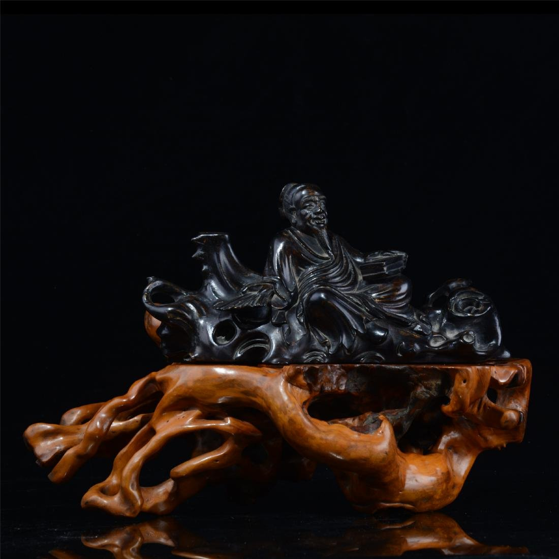 CHINESE EBONY WOOD SEATED MAN