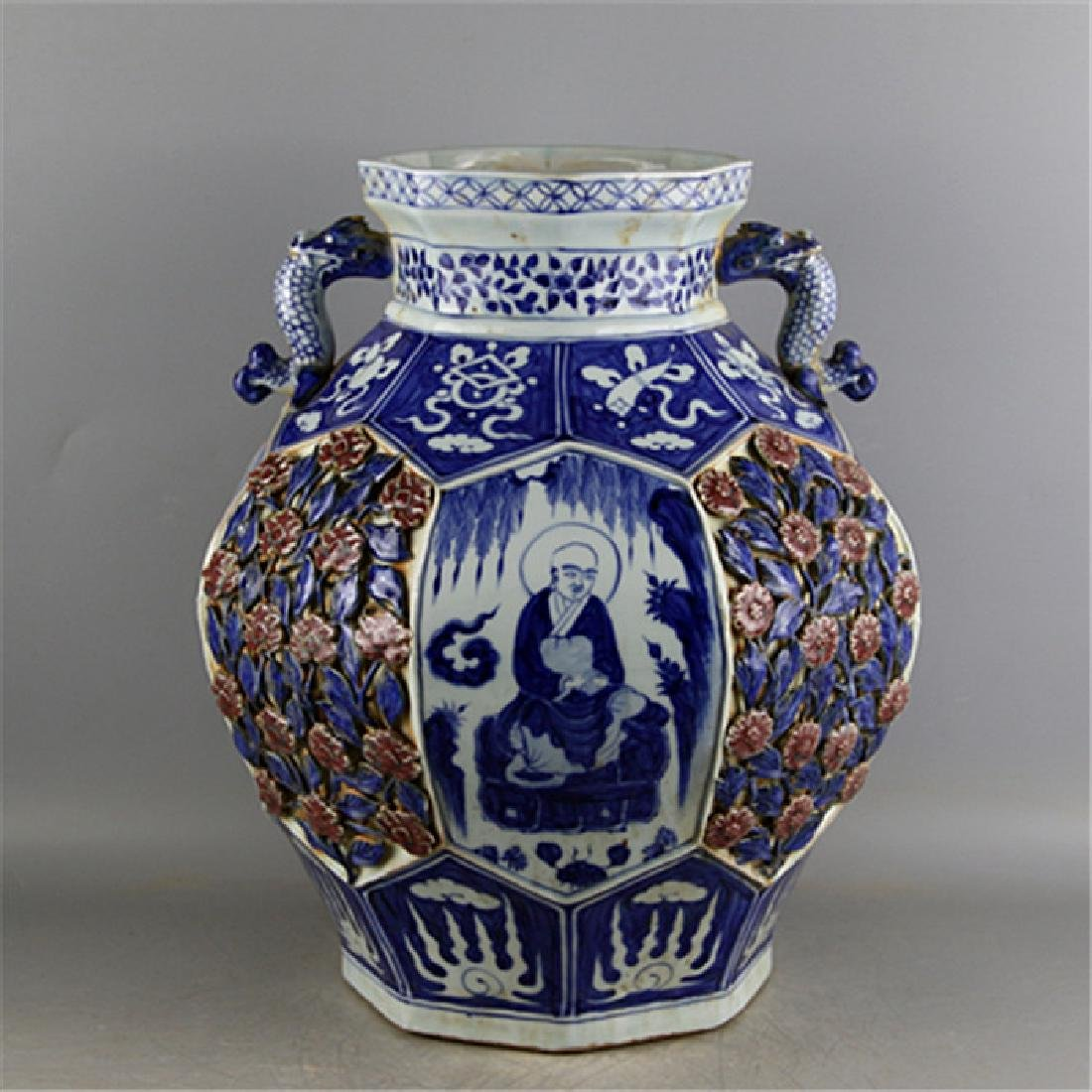 CHINESE PORCELAIN BLUE AND WHITE RED UNDER GLAZE LOHAN