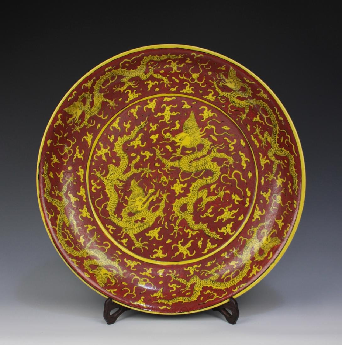 CHINESE PORCELAIN RED GROUND YELLOW DRAGON CHARGER