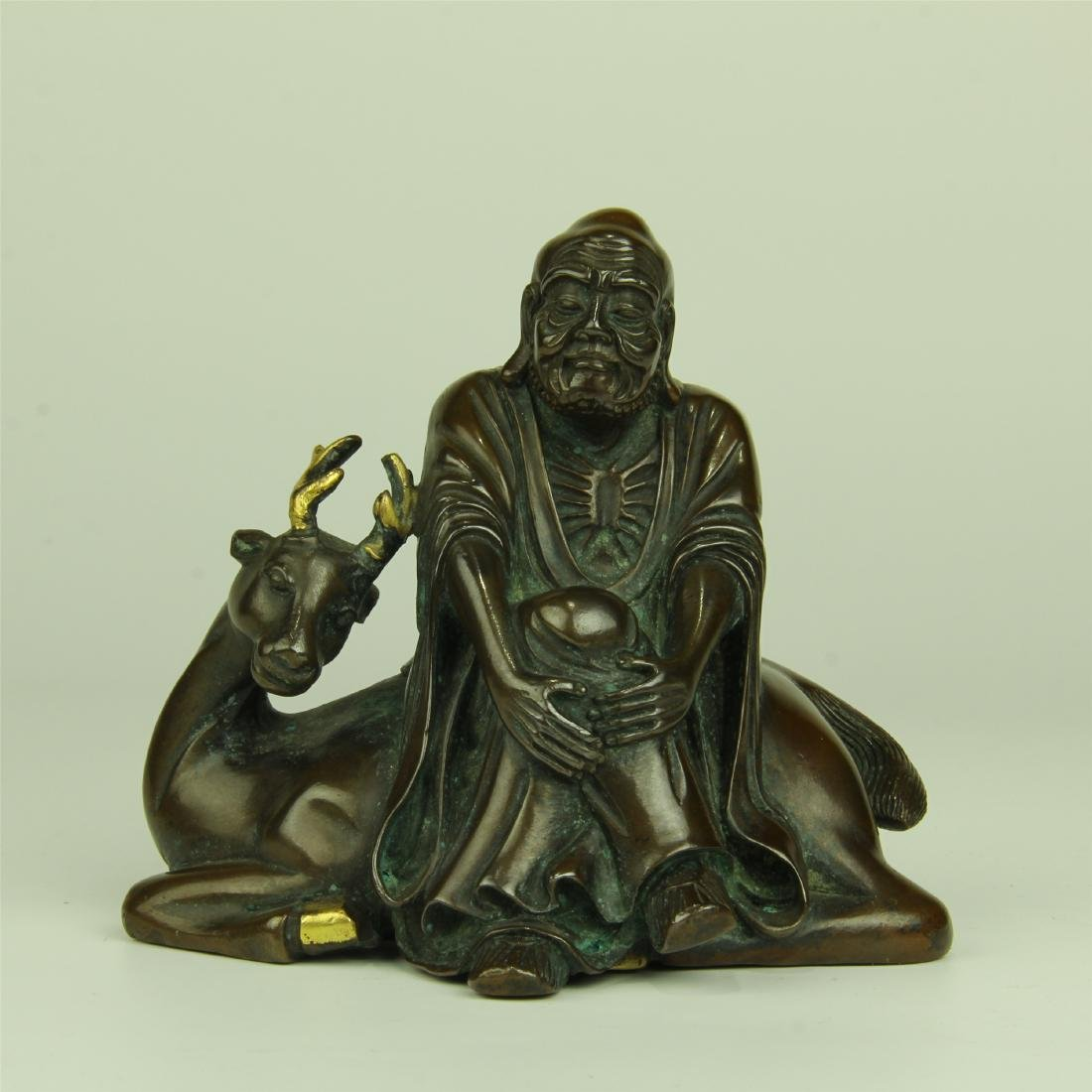 CHINESE BRONZE SEATED LOHAN AND DEER