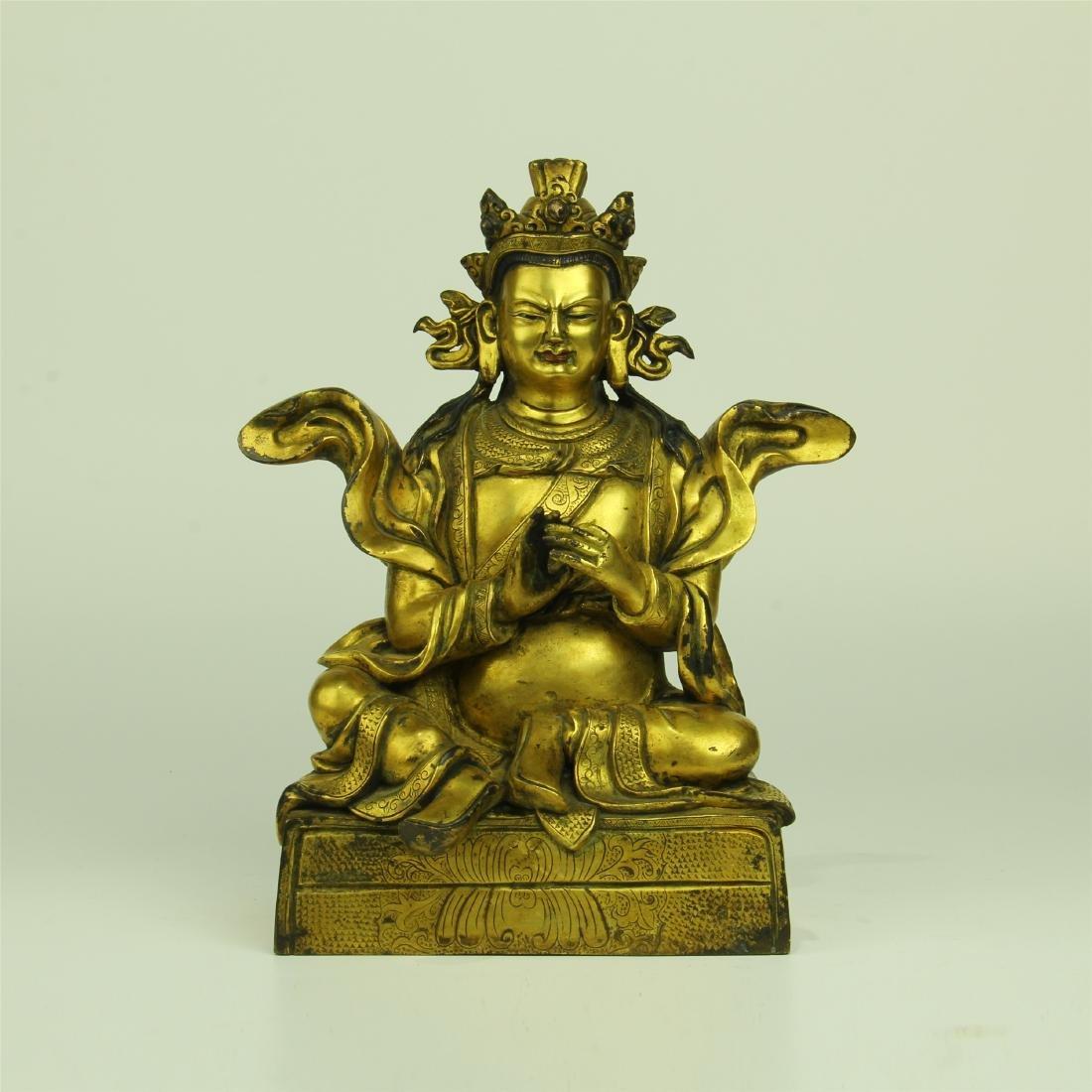 CHINESE GILT BRONZE SEATED GURU BUDDHA