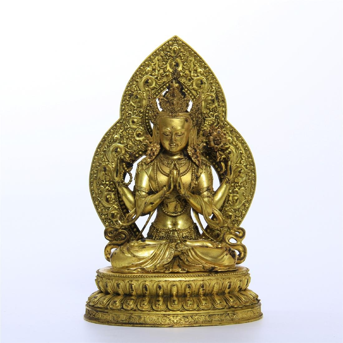 CHINESE GILT BRONZE FOUR ARM SEATED GUANYIN