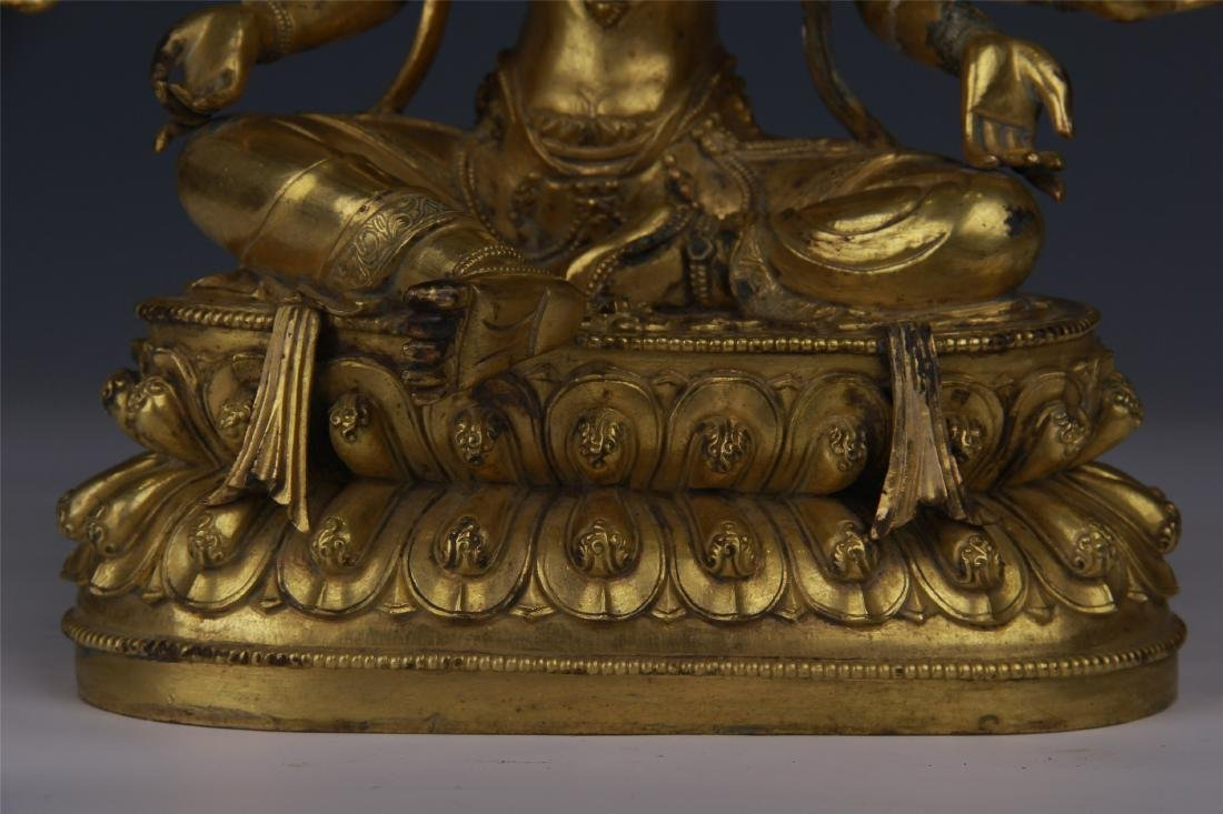 TIBETAN GILT BRONZE SEATED THREE FACE EIGHT ARM BUDDHA - 4