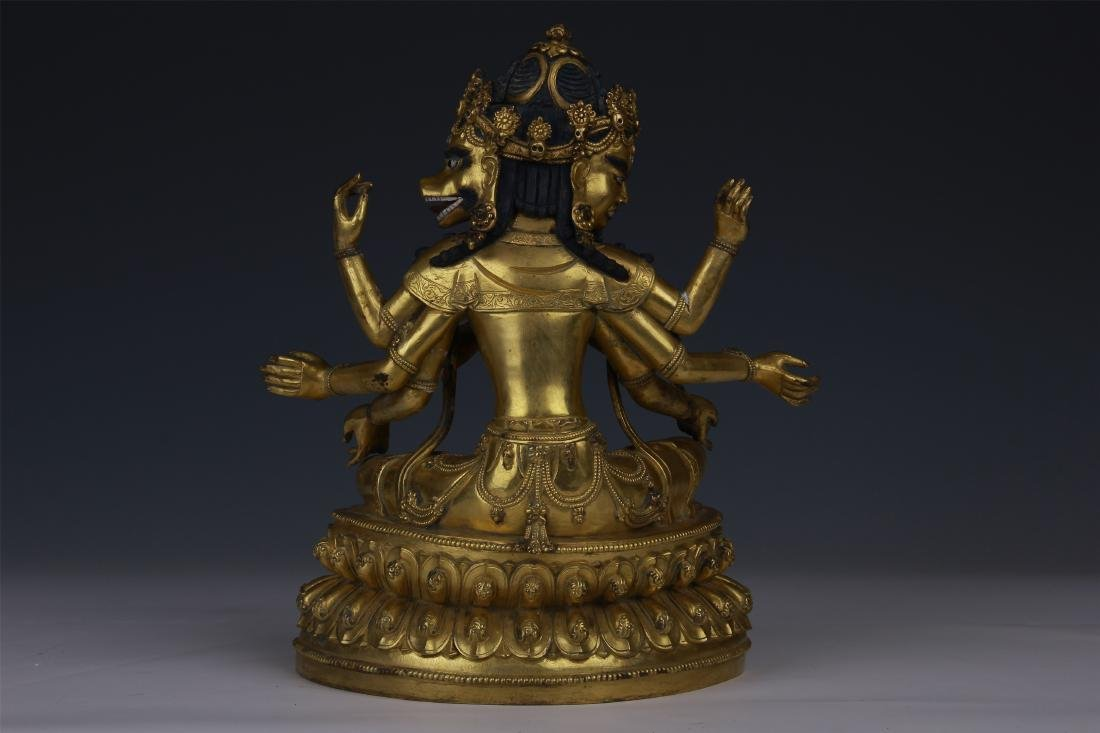 TIBETAN GILT BRONZE SEATED THREE FACE EIGHT ARM BUDDHA - 6