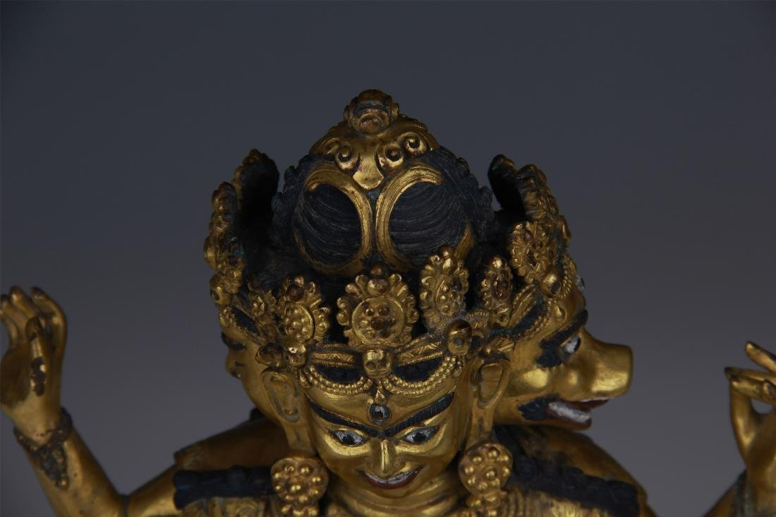 TIBETAN GILT BRONZE SEATED THREE FACE EIGHT ARM BUDDHA - 9